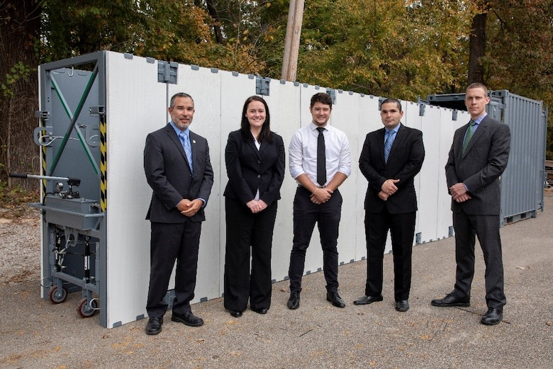 The Ready Armor Protection for Instant Deployment, or RAPID, invention team poses in front of their invention. Team members include, from left, the U.S. Army Engineer Research and Development Center-Geotechnical and Structures Laboratory's Survivability Engineering Branch members Omar Esquilin-Mangual, team leader; Dr. Catherine Stephens; Erik Chappell; branch chief Omar Flores; Carey Price and Andrew Edwards of Edwards Design and Fabrication, not pictured.