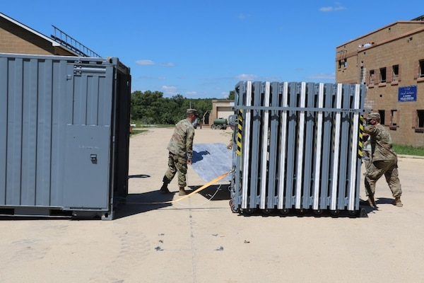 Soldiers deploy the U.S. Army Engineer Research and Development Center's  Ready Armor Protection for Instant Deployment, or RAPID, full armor configuration at the Maneuver Support, Sustainment and Protection Integration Experiments 2020 (MSSPIX20).