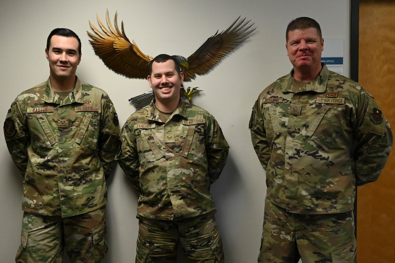 U.S. Air Force Staff Sgt. Indiana Pastor (left), Staff Sgt. Nathan Fancher, and Master Sgt. Michael Rosatone, all assigned to the 14th Operations Support Squadron, pose for a photo Dec. 2, 2020 on Columbus Air Force Base, Miss. Rosatone received the Air Education and Training Command Outstanding Aircraft Flight Equipment Senior Non Commissioned Officer of the Year Award for 2020. (U.S. Air Force photo by Airman 1st Class Jessica Williams)