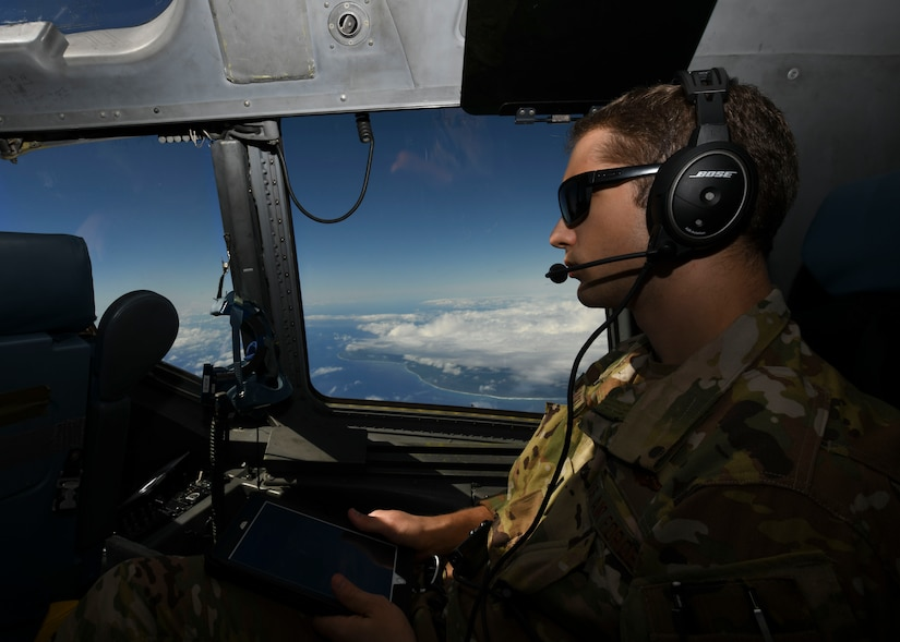 1st Lt. Jake Niedbalski, a C-17 Globemaster III pilot assigned to the 15th Airlift Squadron at Joint Base Charleston, S.C., flies over the Caribbean Sea en-route to Naval Station Guantanamo Bay (NSGB), Cuba, Nov. 12, 2020. The 15th AS flew an off-station trainer to NSGB to deliver two Halverson loaders and bring two Halverson loaders back to Charleston. The aircrew also conducted airfield and low-level training at Guantanamo Bay, Cuba, the Florida Keys, Lakeland Linder International Airport and Patrick Air Force Base. Two Airmen, assigned to the 628th Logistics Readiness Squadron at Joint Base Charleston, repaired two loaders before they were loaded onto the jet.