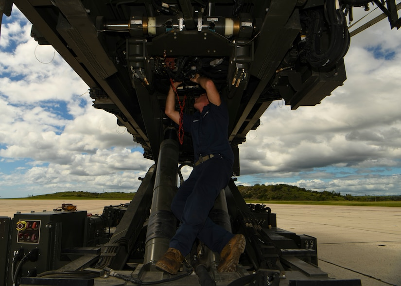 Senior Airman Thomas Franklin, a vehicle mechanic assigned to the 628th Logistics Readiness Squadron at Joint Base Charleston, S.C., performs mechanical work on a Halverson loader at Naval Station Guantanamo Bay (NSGB), Cuba, Nov. 12, 2020.  The 15th AS flew an off-station trainer to NSGB to deliver two Halverson loaders and bring two Halverson loaders back to Charleston. The aircrew also conducted airfield and low-level training at Guantanamo Bay, Cuba, the Florida Keys, Lakeland Linder International Airport and Patrick Air Force Base. Two Airmen, assigned to the 628th Logistics Readiness Squadron at Joint Base Charleston, repaired two loaders before they were loaded onto the jet.