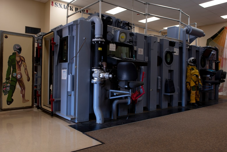 The altitude chamber stands in the lobby of the aerospace physiology building waiting to usher in new pilots into the first steps of training on Dec. 1, 2020, Laughlin Air Force Base, Texas. A chamber used during aerospace or high terrestrial altitude research or training to simulate the effects of high altitude on the human body, especially hypoxia. (U.S. Air Force photo by Airman 1st Class David Phaff)