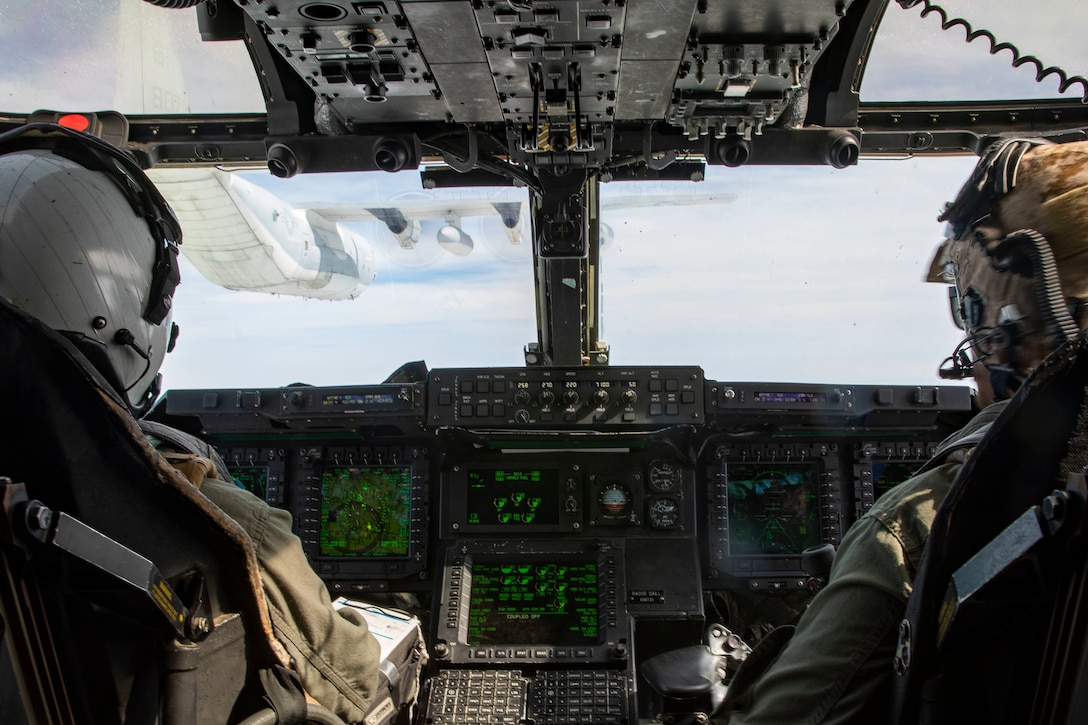 A MV-22B Osprey with Medium Tiltrotor Squadron VMM-263 prepares to receive fuel from a KC-130J Super Hercules from Marine Aerial Refueler Transportation Squadron 252 over the Atlantic Feb. 12, 2020. The Osprey refueled mid-flight during a tactical recovery of air-craft and personnel exercise. (U.S. Marine Corps photo by Cpl. Antonio Garcia/Released)