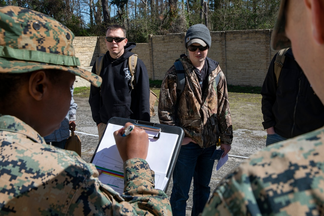 U.S. Marine Sgt. Taylor Wills, a motor vehicle operator with Combat Logistics Battalion, 22nd Marine Expeditionary Unit, documents personnel to be evacuated during a noncombatant evacuation operations training exercise aboard Camp Geiger, N.C., Feb. 27, 2020. Instructors with the Expeditionary Operations Training Group used the exercise to evaluate the unit's efficiency and ability to evacuate civilian noncombatants from a danger area to a designated safe haven in an overseas country. (U.S. Marine Corps photo by Cpl. Antonio Garcia)