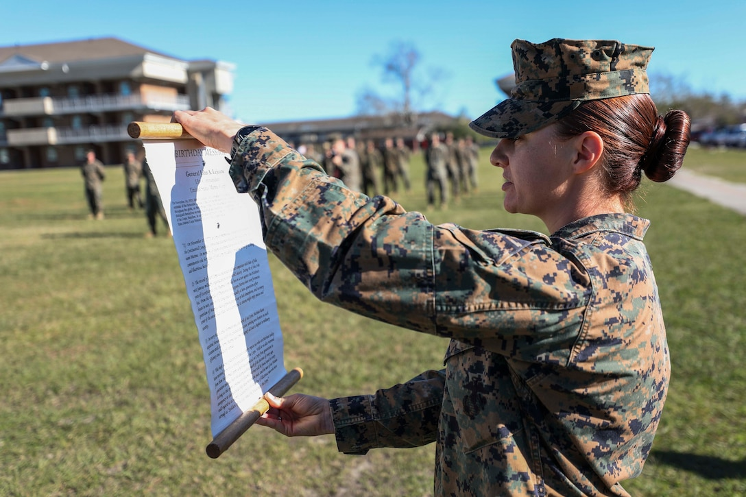 U.S. Marine Corps Capt. Katy Evezich, the 22nd Marine Expeditionary Unit adjutant, reads General John A. Lejeune's birthday message during a cake cutting ceremony to commemorate the 245th Birthday of the United States Marine Corps aboard Camp Lejeune, N.C., Nov. 20, 2020. (U.S. Marine Corps photos by Cpl. Tawanya Norwood)