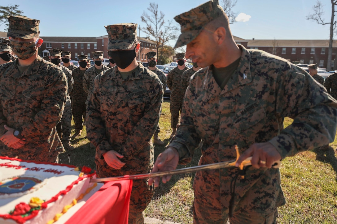 U.S. Marine Corps Col. Paul C. Merida, the 22nd Marine Expeditionary Unit commanding officer, cuts a birthday cake commemorating the 245th Birthday of the United States Marine Corps during a ceremony aboard Camp Lejeune, N.C., Nov. 20, 2020. (U.S. Marine Corps photos by Cpl. Tawanya Norwood)