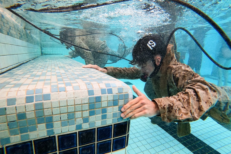 Marines use a device to breath underwater.