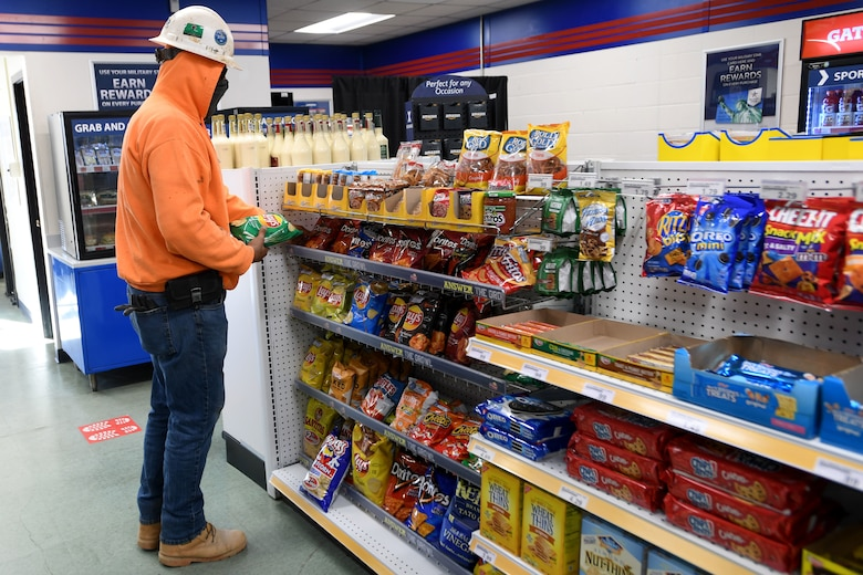 A government contractor takes a break from construction to purchase chips at the Shoppette before heading back to work at the North Carolina Air National Guard Base, Charlotte Douglas International Airport, Dec. 3, 2020. After 14 years of serving Airmen, the Base Shoppette is set to close on December 11, 2020 with plans to possibly re-open after the COVID-19 pandemic subsides.