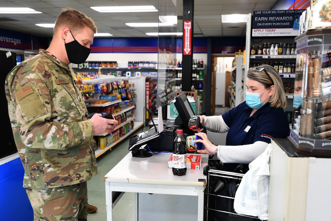 Jennifer Britton, Shoppette Store Manager, assists North Carolina Air National Guardsmen (NCANG) at the Shoppette cash register while they take a break from work to buy snacks and drinks at the NCANG Base, Charlotte Douglas International Airport, Dec. 3, 2020. After 14 years of serving Airmen, the Base Shoppette is set to close on December 11, 2020 with plans to possibly re-open after the COVID-19 pandemic subsides.