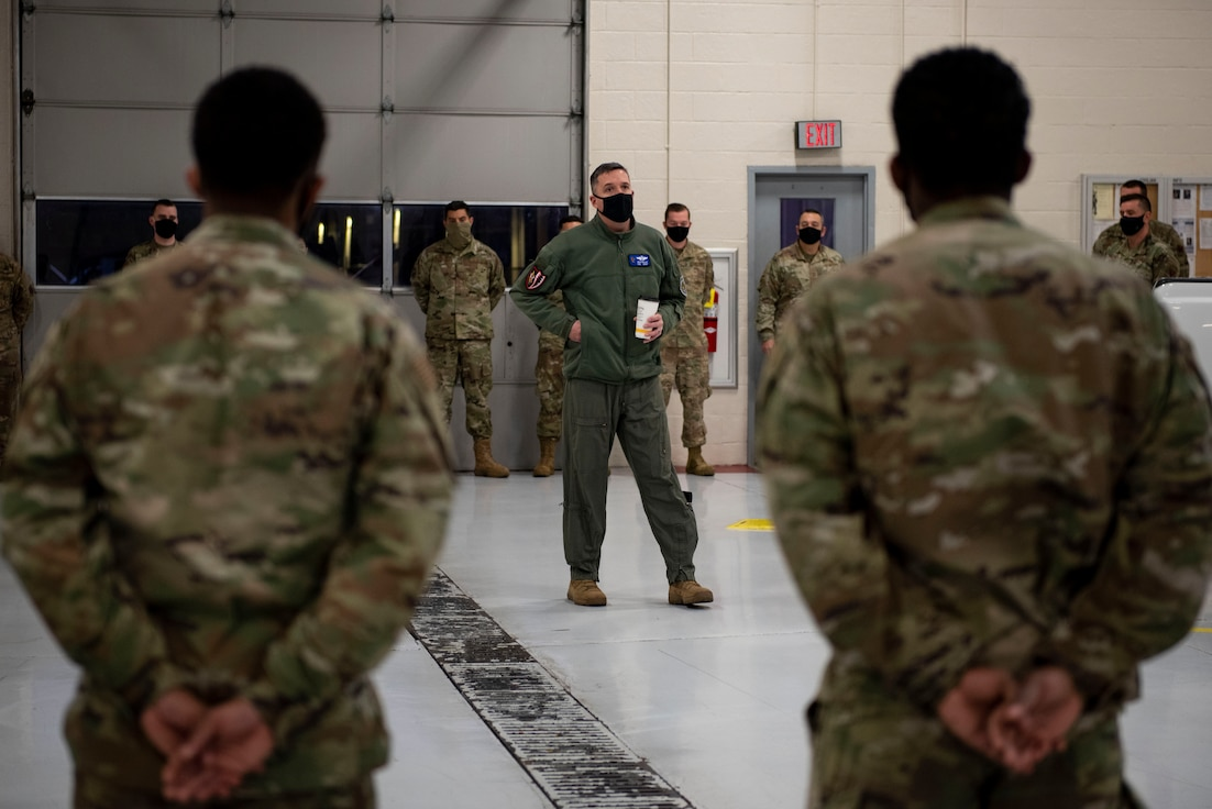 A photo of Col. Dan Walls, 23d Wing commander speaking to Airmen.