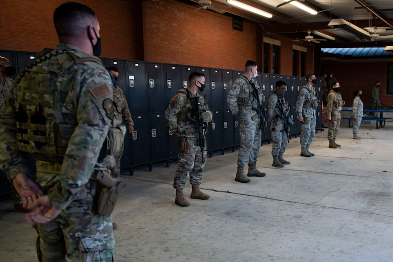 A photo of Airmen listening to leadership during a visit.