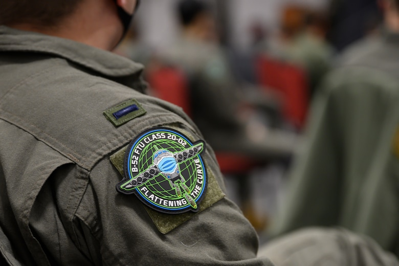 """Photo of FTU Class 20-02 patch with them """"Flattening the Curve""""."""