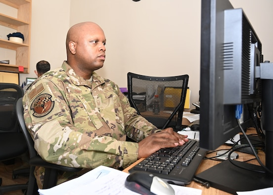 Master Sgt. Robert Perry, 175th Force Support Squadron training manager, works at his computer during a regularly scheduled drill at Warfield Air National Guard Base at Martin State Airport, Sep. 13 2020.