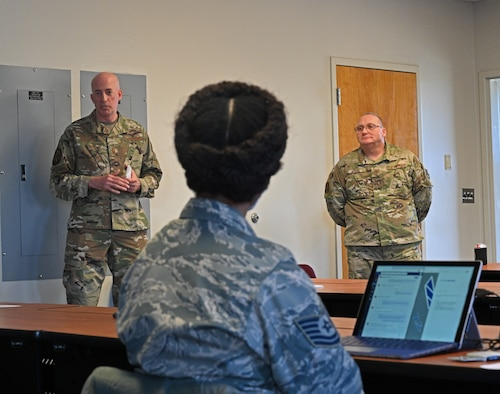 Chief Master Sgt. James Bottorff (left), 175th Mission Support Group superintendent and Chief Master Sgt. Thomas Myers, 175th Communications Squadron superintendent speak with Airmen during the 175th Wing's first additional duty first sergeant's symposium at Warfield Air National Guard Base at Martin State Airport, Middle River, Md., Dec. 2, 2020.