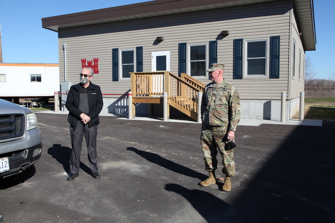Stu Cook, chief of the district Operations Division, left, and Col. Bill Hannan, commander, Kansas City District, Northwestern Division, U.S. Army Corps of Engineers, discuss the new work facility at the Gasconade River Office December 1, 2020 prior to the ribbon cutting. Photo by Jennie Wilson, Visual Information Specialist, Kansas City District, USACE.