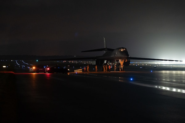 Maintainers deployed for Bomber Task Force operations conduct an inspection on a U.S. Air Force B-1B Lancer at Andersen Air Force Base, Guam, Dec. 12, 2020. The B-1B Lancer is capable of delivering massive quantities of precision and non-precision munitions against any adversary, anywhere in the world at any time. (U.S. Air Force photo by Senior Airman Tristan Day)