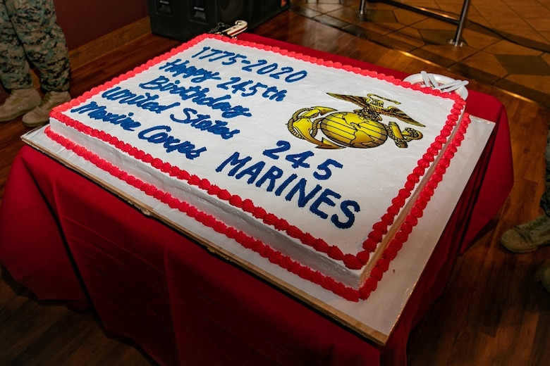 U.S. Marines with 3rd Marine Expeditionary Brigade celebrate the 245th Marine Corps birthday with a cake cutting ceremony at the Bayview Club, Camp Courtney, Okinawa, Japan, Nov. 13, 2020. Marines throughout the world celebrate the Marine Corps birthday in November. During the ceremony, a piece of cake is passed from the oldest Marine to the youngest Marine, which signifies the passing of knowledge and wisdom from one generation to the next. (U.S. Marine Corps photo by Lance Cpl. Natalie Greenwood)