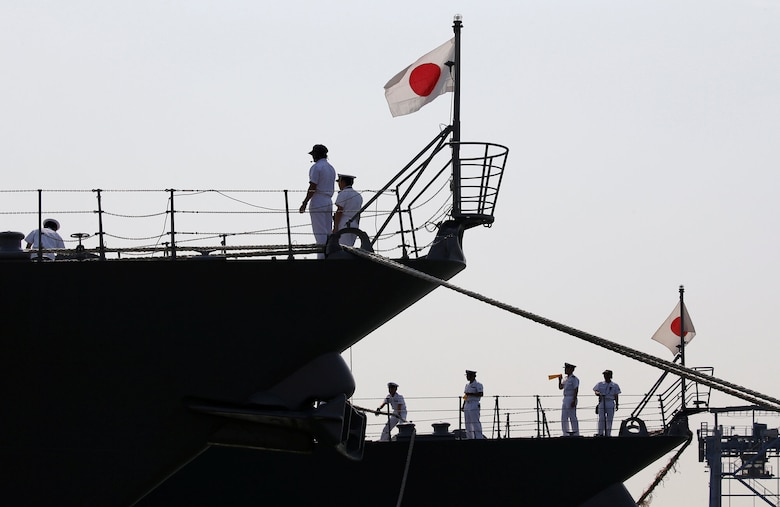 Japan Maritime Self-Defense Force personnel are seen on the destroyers JS Suzutsuki (DD 117) (L) and JS Inazuma (DD 105) after they arrive as part of an Indo-Pacific tour at Tanjung Priok Port in Jakarta, Indonesia, September 18, 2018. REUTERS/Willy Kurniawan