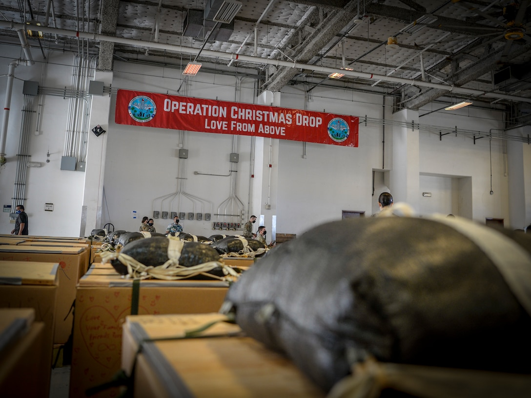 """Bundles housed in the 734th Air Mobility Squadron warehouse await to be loaded onto a C-130J Hercules during the Operation Christmas Drop """"Push"""" Ceremony at Andersen Air Force Base, Guam, Dec. 7, 2020."""