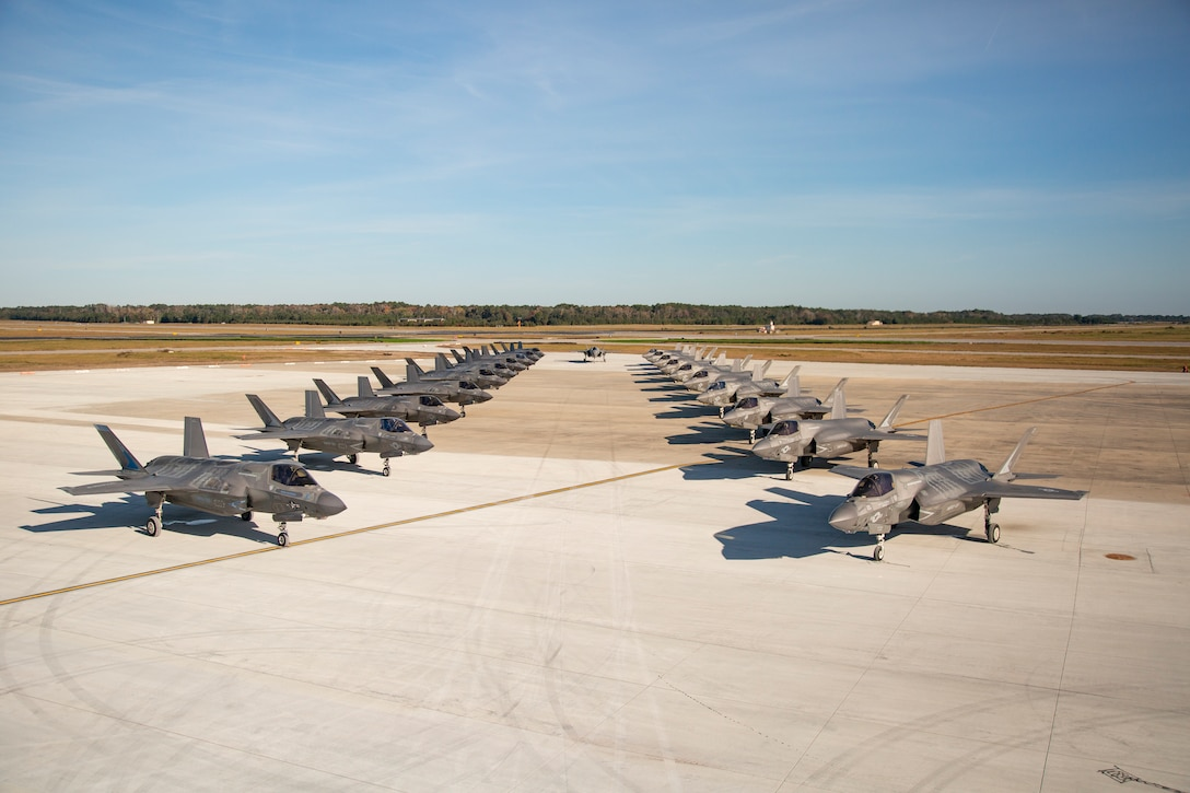Pilots and students assigned to Marine Fighter Attack Training Squadron 501 conduct a max effort launch with 21 F-35B Lightning II aircraft aboard Marine Corps Air Station Beaufort, Nov. 24. The training allowed the unit to conduct a days-worth of flights in a single launch. (U.S. Marine Corps photo illustration by Staff Sgt. Brittney Vella)