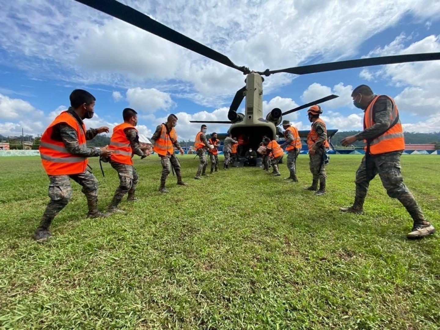 Joint Task Force-Bravo unloads emergency supplies from a U.S. Army CH-47 Chinook