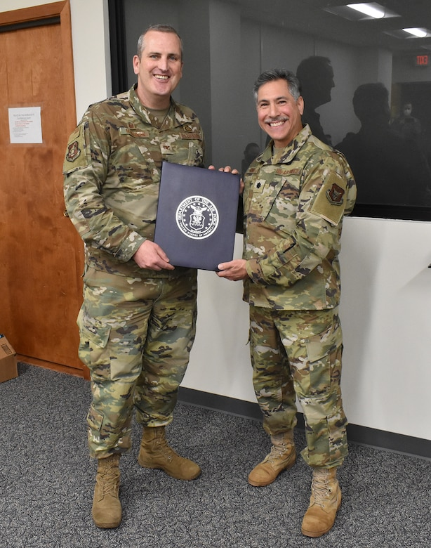 Col. Joseph Marcinek, 655th Intelligence, Surveillance, and Reconnaissance Wing commander, presents Lt. Col. Thomas Danas, 655th ISR Group deputy commander, his retirement certificate during the Dec. 5, 2020 unit training assembly. Danas has held multiple positions within the enterprise since 2013 with both the 16 Intelligence Squadron and 655 ISRG and is retiring after more than 41 years of service; over 20 years enlisted and over 20 years as an officer.