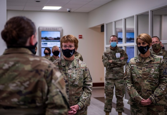 Maj. Miranda Smith, 7th Medical Support Squadron pharmacy flight commander, left, speaks with Lt. Gen. Dorothy Hogg, Air Force Surgeon General, middle, and Chief Master Sgt. Dawn Kolczynski, Chief, Medical Enlisted Force and Enlisted Corps Chief, about the pharmacy's new COVID-19 procedures at Dyess Air Force Base, Texas, Dec. 3, 2020.