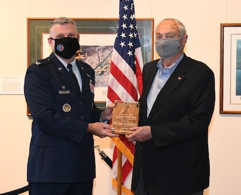 Two men holding plaque