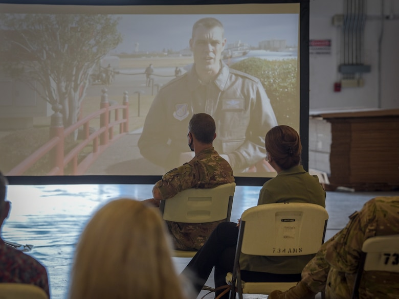 """Col. Andrew Campbell, 374th Airlift Wing commander, virtually speaks at the Operation Christmas Drop """"Push"""" Ceremony at Andersen Air Force Base, Guam, Dec. 7, 2020."""