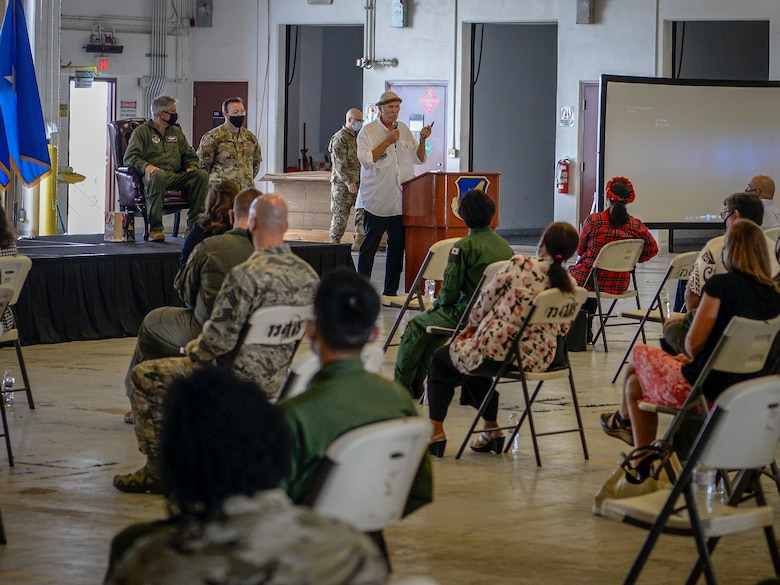 """Bruce Best, telecommunication specialist to Micronesia, speaks at the Operation Christmas Drop """"Push"""" Ceremony at Andersen Air Force Base, Guam, Dec. 7, 2020."""