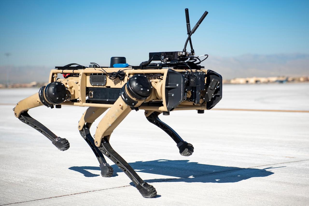 A robot walks in the desert.