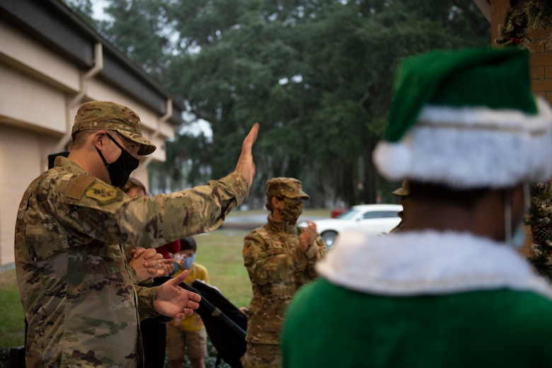 A photo of Col. Dan Walls waving to the audience during a virtual tree-lighting ceremony.
