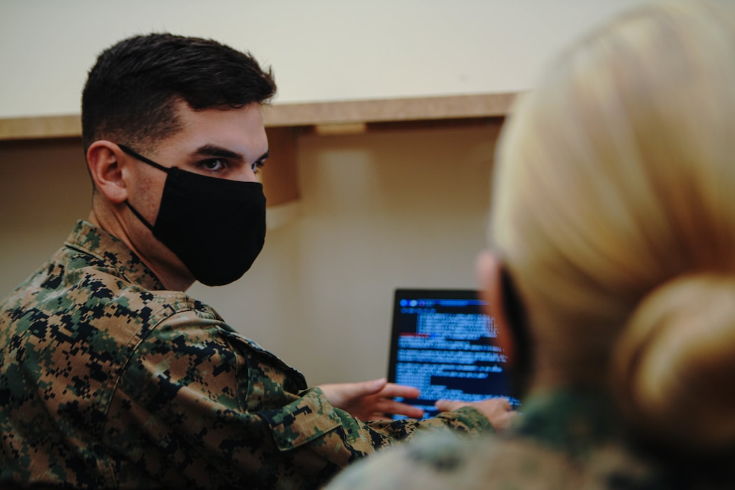U.S. Marine Corps Lance Cpl. Ian Bergman, a defensive cyberspace operator, with 9th Communication (Comm) Battalion, I Marine Expeditionary Force Information Group, hacks into a system while engaged in the Marine Corps 2020 Cyber Games at Marine Corps Base Camp Pendleton, California, Nov. 19, 2020. 9th Comm participated in the cyber games to enhance their skills and to develop tactics and techniques while competing against other teams across the United States. (U.S. Marine Corps photo by Lance Cpl. Patrick Katz)