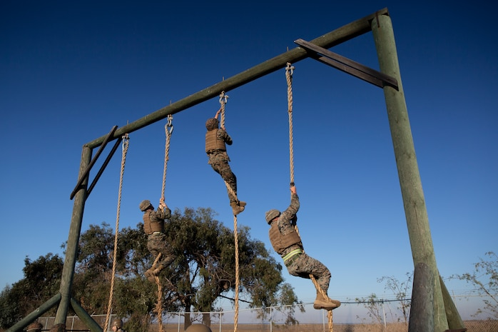 U.S. Marines with 9th Communication Battalion, I Marine Expeditionary Force Information Group climb ropes at the end of an obstacle course during their Marine Corps Martial Arts Program (MCMAP) Instructor course culminating event at Marine Corps Base Camp Pendleton, California, Oct. 29, 2020. MCMAP trains Marines in unarmed combat, edged weapons, weapons of opportunity, and rifle and bayonet techniques. (U.S. Marine Corps photo by Lance Cpl. Marcus Melara)