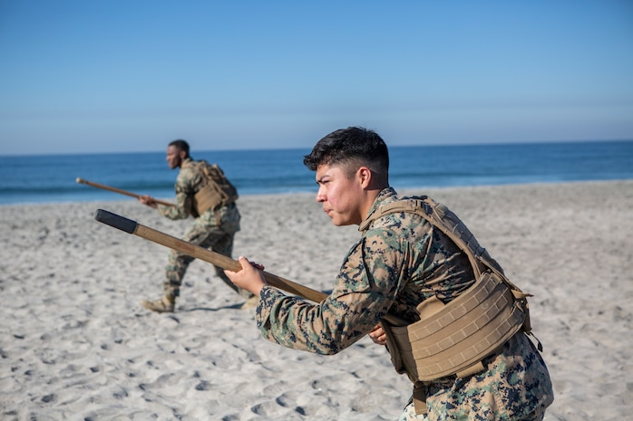 U.S. Marines with 9th Communication Battalion, I Marine Expeditionary Force Information Group test bayonet techniques during their Marine Corps Martial Arts Program (MCMAP) Instructor course culminating event at Marine Corps Base Camp Pendleton, California, Oct. 29, 2020. MCMAP trains Marines in unarmed combat, edged weapons, weapons of opportunity, and rifle and bayonet techniques.  (U.S. Marine Corps photo by Lance Cpl. Marcus Melara)