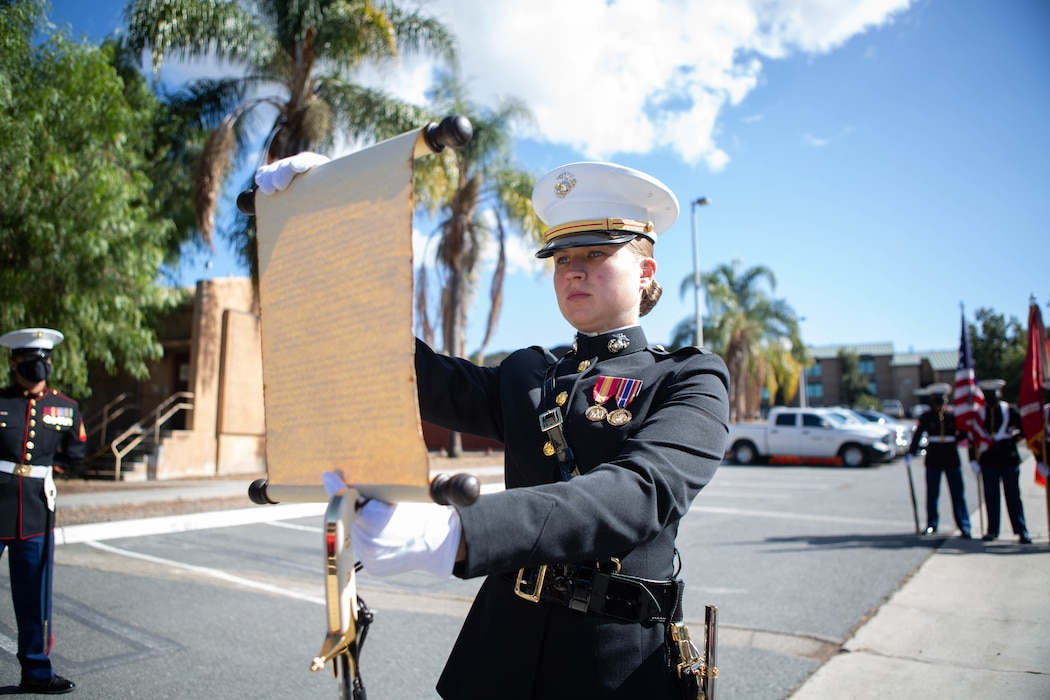 U.S. Marine Corps 2nd Lt. Hattie Smith, a manpower officer with I Marine Expeditionary Force Information Group (I MIG) reads the 13th Commandant Gen. John A. Lejeune's, birthday message during a cake cutting ceremony at Marine Corps Base Camp Pendleton, California, Nov. 9, 2020. I MIG hosted the cake cutting ceremony in lieu of the Marine Corps 245th Birthday Ball to honor the long standing tradition of celebrating the birth date and legacy of the United States Marine Corps. (U.S. Marine Corps photo by Cpl. Tia D. Carr)