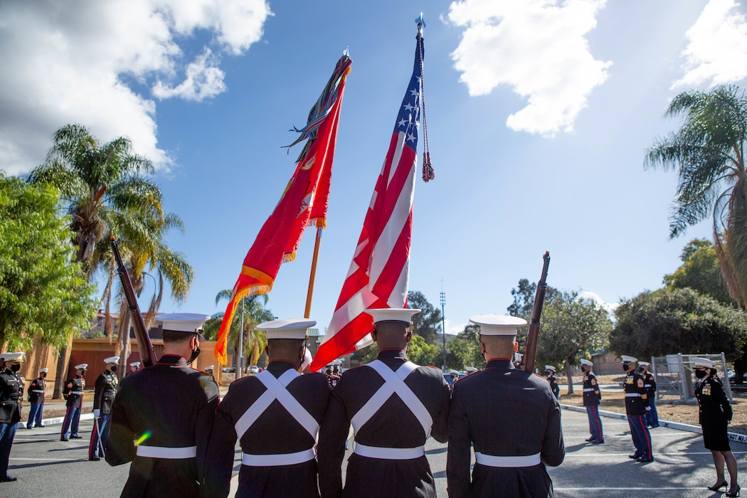 U.S. Marines with I Marine Expeditionary Force Information Group (I MIG) color guard march the colors during a cake cutting ceremony at Marine Corps Base Camp Pendleton, California on Nov. 9, 2020. I MIG hosted the cake cutting ceremony in lieu of the Marine Corps 245th Birthday Ball to honor the long standing tradition of celebrating the birth date and legacy of the United States Marine Corps. (U.S. Marine Corps photo by Cpl. Tia D. Carr)