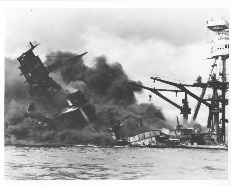 Original caption: Burning and damaged ships at Pearl Harbor, Dec. 7 1941. Photo courtesy of the U.S. National Archives and Records Administration.