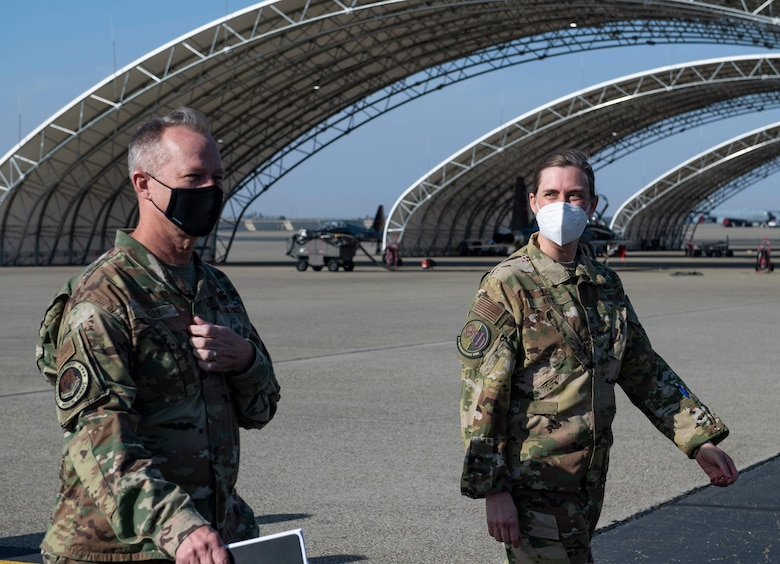 U.S. Air Force Gen. Mark Kelly, left, commander of Air Combat Command engages with Col. Heather Fox, 9th Reconnaissance Wing commander, as he begins a mission, Airmen, and capabilities immersion at Beale Air Force Base.