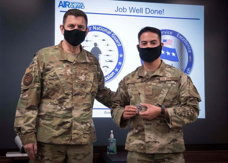 Airman receives coin from General Loh