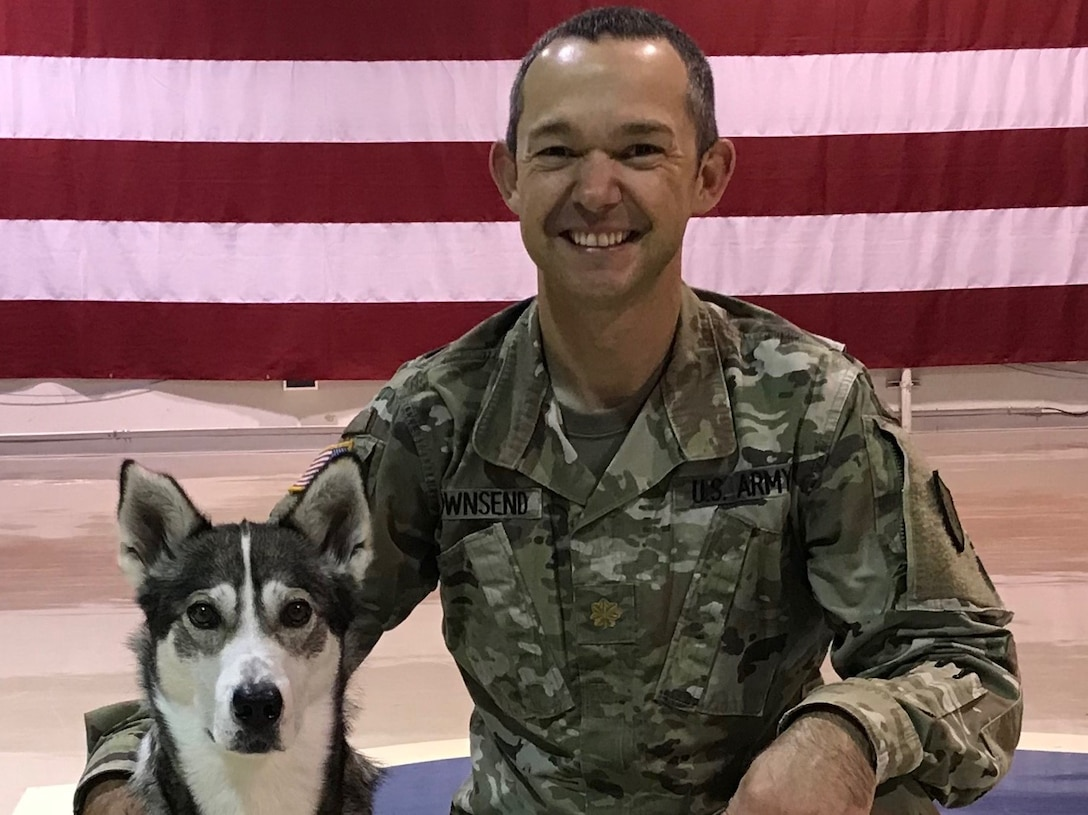 Maj. Troy Townsend, director of psychological health, NHARNG, and therapy dog, Cache, work under the Office of the State Surgeon.