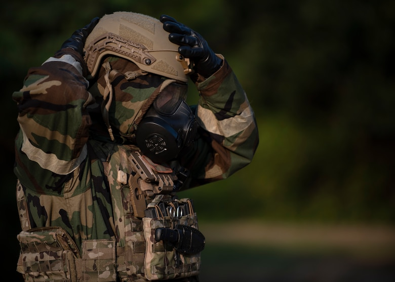 Airman First Class Brian Price, 4th Civil Engineer Squadron Explosive Ordnance Disposal apprentice, adjusts his personal protective equipment before beginning a chemical operation training exercise at Seymour Johnson Air Force Base, North Carolina, August 27, 2020.