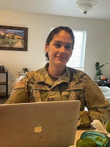 Tech. Sgt. Eunice Bivins teleworks from her home office in Salt Lake City, Utah.. Bivins is partnered with Utah County in contacting people after they receive a positive COVID-19 test.