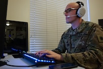 2nd Lt. Blase Barker teleworks in his home office in Salt Lake City contacting people after they receive a positive COVID-19 test.