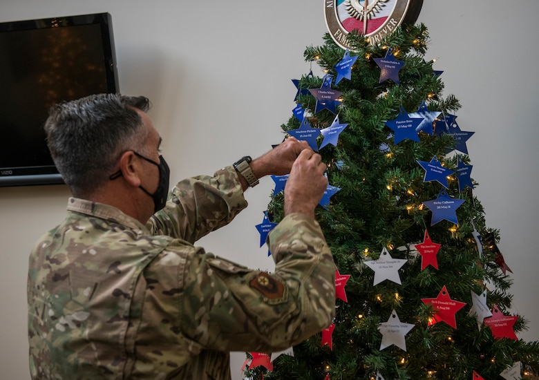 U.S. Air Force Maj. Gen. Eric Hill, deputy commander of Air Force Special Operations Command, places stars on an Honor Tree