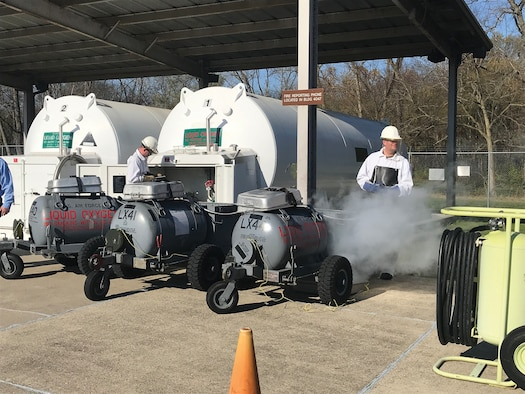 Senior Airman Jeremy Miller, fuels technician, and Tech. Sgt. Richard Blake, NCO in charge of operations, 445th Logistics Readiness Squadron fuels management flight, service liquid oxygen (LOX) carts during the Nov. 6, 2020 unit training assembly. The FMT conducts samples prior to filling the LOX carts. If the sample results in an odor that is similar to rotten eggs, then the batch of LOX is discarded.