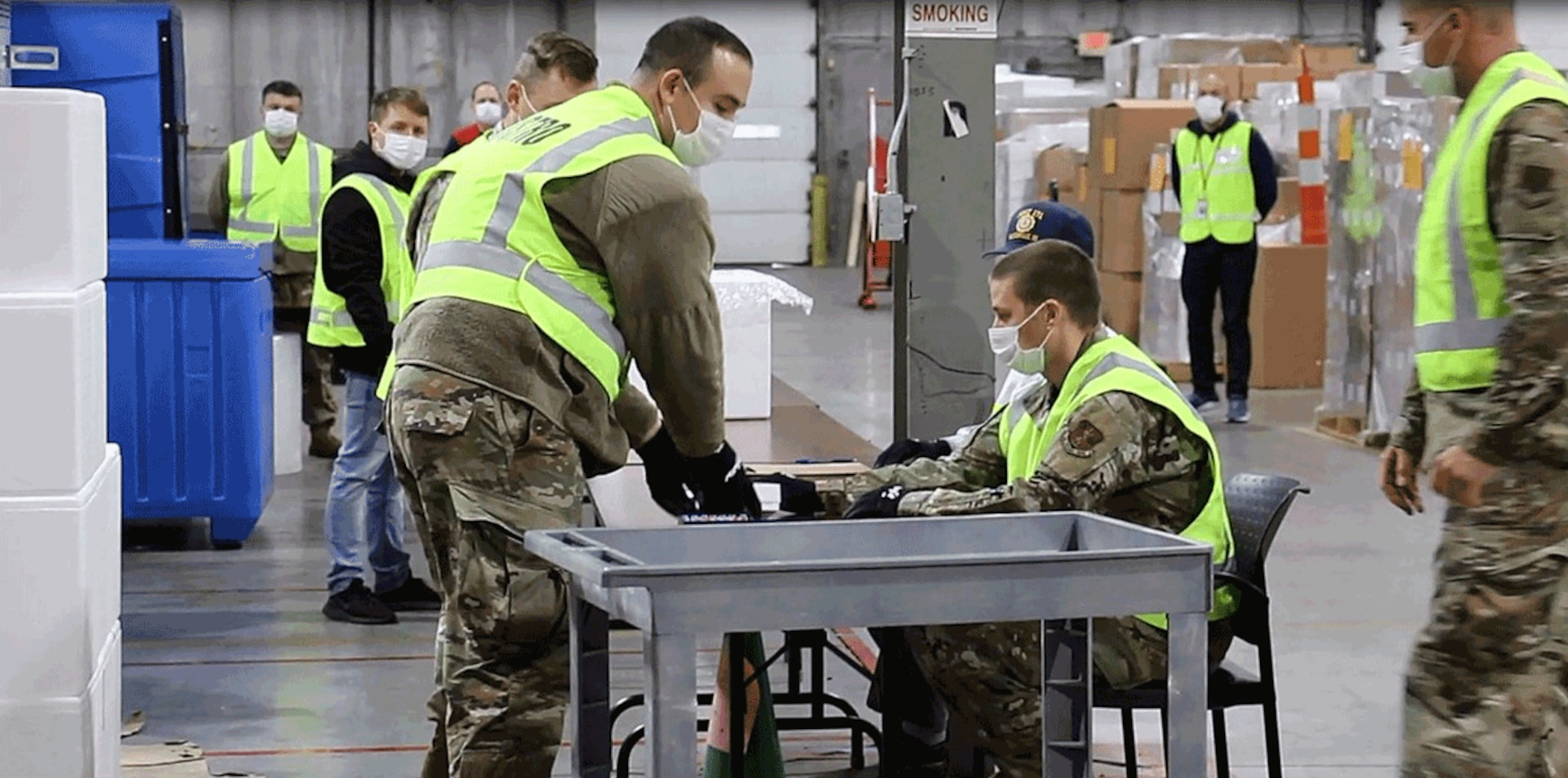 Military and civilian partners form an assembly line around tables and practice safely transferring glass vials into small boxes. About two dozen Guard members have been working with the Ohio Department of Health to develop the logistics plan to receive and repackage the COVID-19 vaccine for distribution.