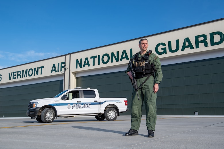 Officer James Sides, 158th Security Forces Squadron civilian security operations supervisor, stands for a portrait at the Vermont Air National Guard base.