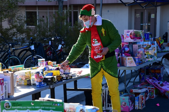 Santa's elf, Tech. Sgt. Charles Shaw, 926th Wing volunteer, is getting into the spirit while organizing and displaying everything to prepare for the 926th Wing Airman and Family Readiness Operation Holiday Hope event, Dec. 5, 2020 at Nellis Air Force Base, Nev. (U.S. Air Force photo by Staff Sgt. Paige Yenke)