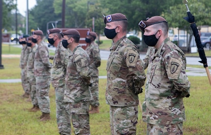 Company commanders and first sergeants stand in front of their formations during the 1st Battalion, 54th Security Force Assistance Brigade activation ceremony at Fort Benning, Georgia, June 25, 2020.